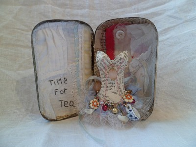 A vintage tin art assemblage